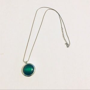 Long necklace with green pendant